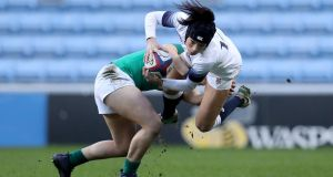 England's Kelly Smith is tackled by Katie Fitzhenry of Ireland during the Women's Six Nations match at the Ricoh Arena in Coventry. Photograph: Tommy Dickson/Inpho
