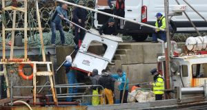 Debris from Rescue 116 is taken from a trawler at Blacksod pier in Co Mayo. Photograph: Dara Mac Dónaill