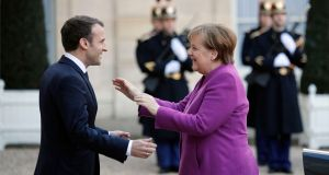 "Emmanuel Macron welcomes Angela Merkel at the Elysee Palace in Paris: ""Europe must present a united front,"" says Dr Merkle. ""When France and Germany propose things, they have a good chance of happening."" Photograph: François Mori"
