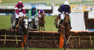 Farclas (left) ridden by  Jack Kennedy clears the last hurdle before going on to win The JCB Triumph Hurdle Race on the final day of the Cheltenham Festival. Photograph: Getty Images