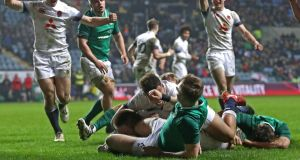 England's Joe Heyes score a try during the Under-20 Six Nations Championship match against Ireland at the Ricoh Arena in Coventry. Photograph: Tommy Dickson/Inpho
