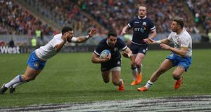 Sean Maitland  scores Scotland's third try during the  Six Nations match against  Italy  at Stadio Olimpico  in Rome. Photograph: Paolo Bruno/Getty Images
