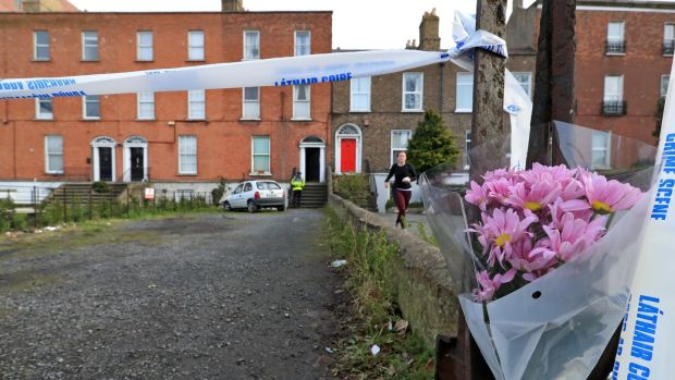 Flowers at the scene at the house on Ranelagh Road, Dublin where the body of Joanne Ball was discovered in a wardrobe. Photograph: Collins