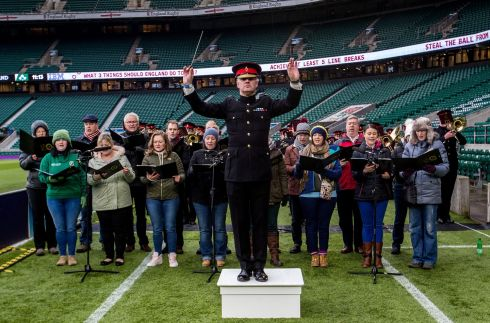 Conductor of The Band of the household cavalry with the RAF spitfires choir practicing ahead of the match. Photograph: Inpho