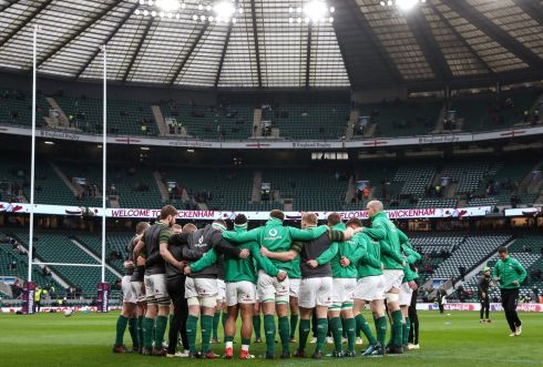 The Irish team gather in a huddle before their warm-up. Photograph: Inpho