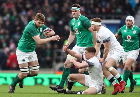 Ireland's Iain Henderson spots a gap as Owen Farrell can only look on. Photograph: Inpho