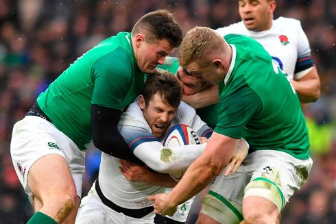 England's wing Elliot Daly is tackled by Jacob Stockdale Dan Leavy. Photograph: Getty Images