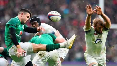 Ireland's scrumhalf Conor Murray clears as Chris Robshaw tries to block him. Photograph: Getty Images