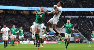 Ireland fullback  Rob Kearney gets up to challenge his England counterpart  Anthony Watson leading to the opening try of the Six Nations game at Twickenham. Photograph:  Gareth Fuller/PA Wire