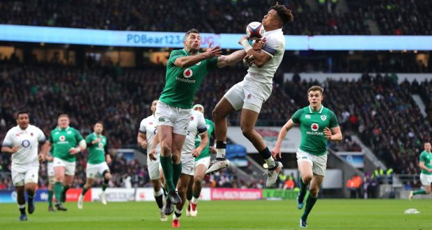 c9a3a4663a2 Ireland fullback Rob Kearney gets up to challenge his England counterpart  Anthony Watson leading to the