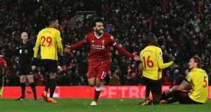 Liverpool's Mohamed Salah celebrates scoring a hat-trick during the Premier League match at Anfield, Liverpool. Photo: Anthony Devlin/PA Wire