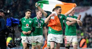 Ireland celebrate beating England to seal the Grand Slam. Photograph: PA
