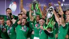 Ireland captain Rory Best  lifts the Six Nations trophy after they clinched the Grand Slam by beating England 24-15 at Twickenham. Photograph: Will Oliver/EPA