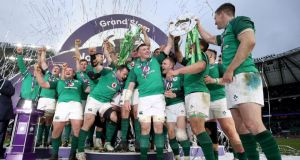 Ireland celebrate winning the Grand Slam at Twickenham. Photo: Dan Sheridan/Inpho