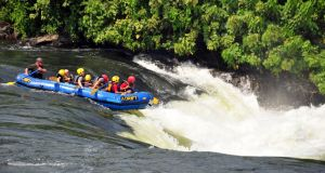 Bujagali Falls, Uganda: a group of whitewater rafters on an inflatable boat going down the rapids. Photograph: Getty Images