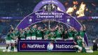 The Ireland team celebrate with the NatWest Six Nations trophy and the Triple Crown trophy after their match against England at Twickenham. Photograph: Laurence Griffiths/Getty Images