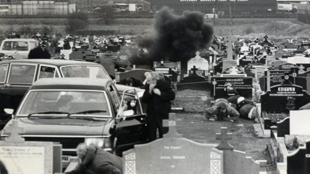 Mourners take cover in Milltown cemetery in Belfast on March 16th, 1988, as a grenade explodes during Michael Stone's attack on the funeral of three IRA members. Photograph: Paddy Whelan