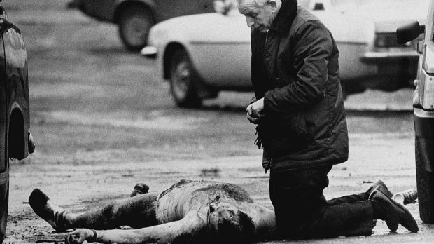 Fr Alex Reid gives last rites to one of the two soldiers murdered. Photograph: George Jackson