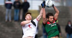 Mayo's Tom Parsons  gets the ball ahead of Tyrone's Cathal McShane during the Allianz Football League Division One game at  Elverys MacHale Park. Photograph: Evan Logan/Inpho