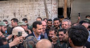 Syrian president Bashar al-Assad  talking with government troops in eastern Ghouta in the leader's first trip to the former rebel enclave outside Damascus in years. Photograph: AFP /  Syrian presidency Facebook page