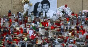 Candles sit in front of a photo of journalist Jan Kuciak and his fiancée during an anti-government rally in Bratislava, Slovakia, last week. The country-wide protests demand a thorough investigation into the shooting deaths of Jan Kuciak and Martina Kusnirova, whose bodies were found in their home on February 25th. Photograph: Ronald Zak/AP