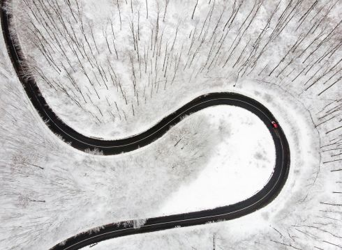 MOUNTAIN TRAIL: An aerial photo shows a motorist driving on a road that leads through the snow-covered forests of the Pilis mountains in Hungary. Photograph: Balazs Mohai/MTI via AP
