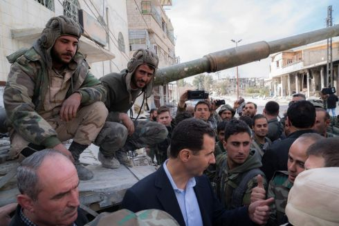 SYRIAN CONFLICT: Syrian president Bashar al-Assad talks with regime forces in eastern Ghouta. Photograph via AFP Photo