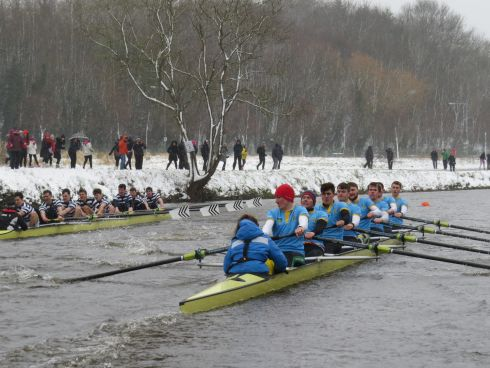 IN A ROW: Trinity's eight overtake UCD in a Gannon Cup race on the river Liffey. Photograph: Liam Gorman