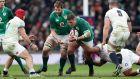 Ireland's Tadhg Furlong supported by Iain Henderson goes on a charge against England at Twickenham during Six Nations match. Photograph: Inpho