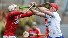 Waterford's Tadhg de Burca under pressure from Patrick Horgan of Cork. Photograph: Cathal Noonan/Inpho