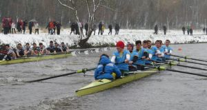 Gannon Cup: Trinity's eight (left) overtake UCD in a thrilling race on the Liffey. Photograph: Liam Gorman