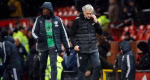 Manchester United manager Jose Mourinho leaves the pitch alongside Paul Pogba after the FA Cup quarter-final win over Brighton at Old Trafford. Photo: Martin Rickett/PA