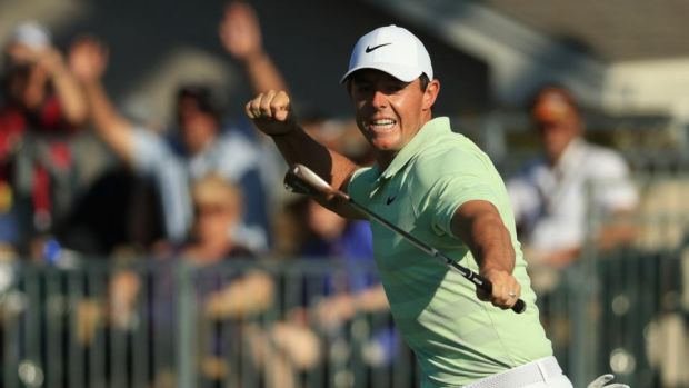 McIlroy celebrates after chipping in for birdie on the 15th. Photo: Mike Ehrmann/Getty Images
