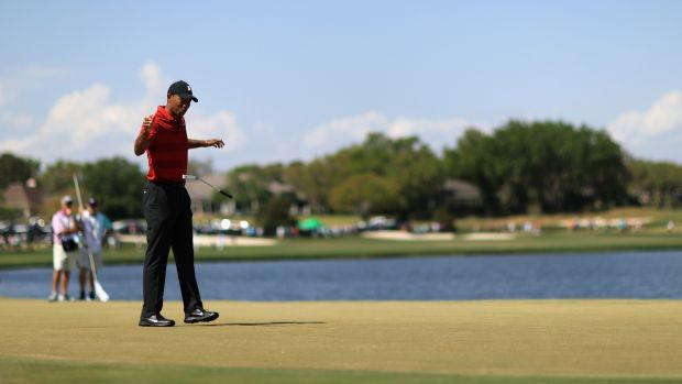 Woods reacts to his putt on the sixth hole during the final round. Photo: Mike Ehrmann/Getty Images