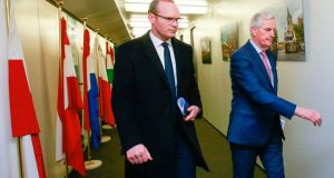 Minister for Foreign Affairs Simon Coveney (left) walks with European Chief Negotiator Michel Barnier, prior to a meeting in Brussels on Monday. Photograph:  AFP/Pool