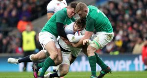 Ireland's Jacob Stockdale and Dan Leavy tackle England's Elliot Daly at Twickenham. Photograph: Dan Sheridan/Inpho