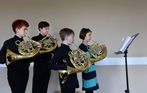 FRENCH HORN CONTEST: Eamon Burke, of Dun Laoghaire, Benjamin Brennan, Terenure, Harry Dunne, Rathoth, Co Meath, and Rhea Flatley, Blackrock, Dublin, all members of the DIT junior horn group, practising for the Junior French Horn competition at the ESB Feis Ceoil in the RDS. Photograph: Dara Mac Donaill/The Irish Times