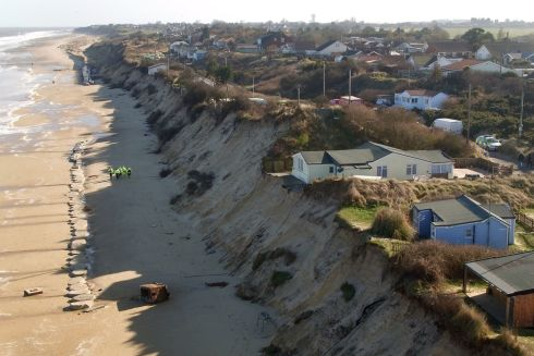 INCHING CLOSER: Houses sit perilously on a cliff edge on The Marrams in Hemsby, Norfolk, where parts of the cliff collapsed into the sea after recent bad weather.  Ten properties have been evacuated after fears the houses could soon fall into the sea. Photograph: Joe Giddens/PA Wire