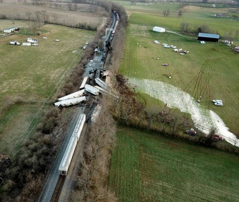 DERAILMENT: Train cars lie derailed across tracks and on nearby hills following a major rail incident in Georgetown, Kentucky, US. Two freight trains collided and derailed shortly before midnight, injuring four people and igniting a fire that forced nearby residents to evacuate. Photograph: Ron Garrison/Lexington Herald-Leader/AP