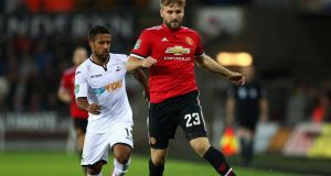 Luke Shaw: will not be forced out of Manchester United this summer against his wishes. Photograph:  Michael Steele/Getty Images