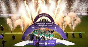 Crowning glory:  Ireland  celebrate with the  Six Nations trophy and the Triple Crown  after the victory over England at Twickenham Stadium. Photograph:  Shaun Botterill/Getty Images
