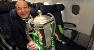 Rory Best with the Six Nations trophy on the team's flight back to Dublin. Photograph: Inpho