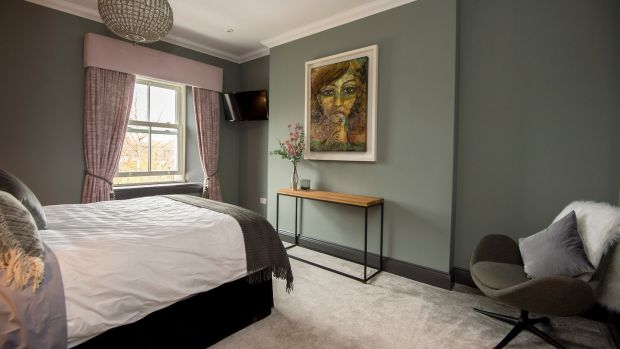 'Although we are now in a smaller bedroom, it actually feels bigger as we just have the bed, two side tables and a nursing chair'. Photograph: Brenda Fitzsimons