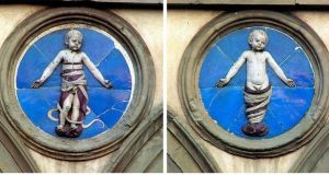 Glazed terra-cotta reliefs by Andrea della Robbia of swaddled babies at the Ospedale degli Innocenti in Florence
