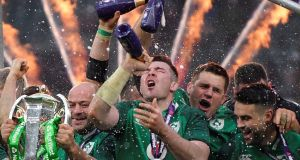 Ireland's Rory Best, Peter O'Mahony and team mates celebrate with the Six Nations trophy during the presentation at the end of the match. Photo: Toby Melville/Reuters