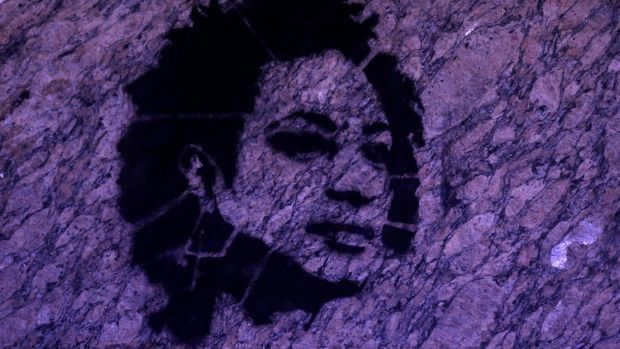 A stencil image of Rio de Janeiro city councillor Marielle Franco, who was murdered last week, on the wall of the city council chamber. Photograph: Ricardo Moraes/Reuters