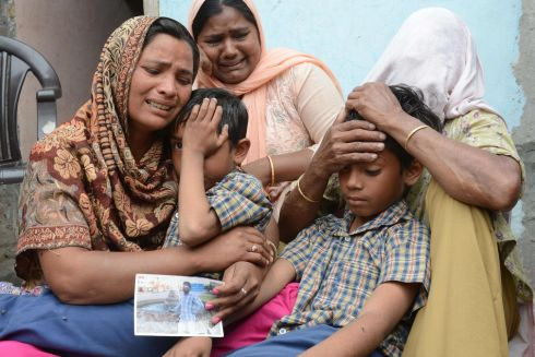 ISLAMIC STATE VICTIMS: Indian woman Seema (left), her sons Karan and Arjun and her mother in-law Jeeto react after confirmation by external affairs minister Sushma Swaraj that her husband Sonu was killed in Iraq in the village of Chawinda Devi. The bodies of 39 Indian construction workers kidnapped in Iraq in 2014 by the Islamic State group were found in a mass grave and have been identified, India's foreign minister said. Photograph: Narinder Nanu/AFP/Getty Images