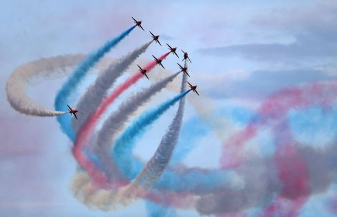 IN FULL COLOUR: The Red Arrows aerobatics display team perform at the Bournemouth Air Festival. A Red Arrows jet crashed on Tuesday after an incident at RAF Valley in north Wales, the British Ministry of Defence said. Photograph: Andrew Matthews/PA Wire