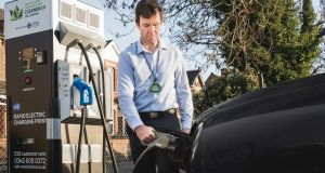 Fully charged:  black cab driver  John Dowd at one of the new charging points