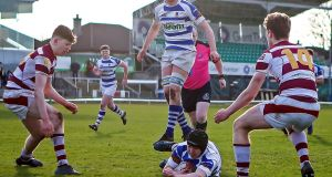 Garbally College's Cathal Dolan scores a try  against Coláiste Iognáid in the Connacht Schools Senior Cup final. Photograph: Laszlo Geczo/Inpho